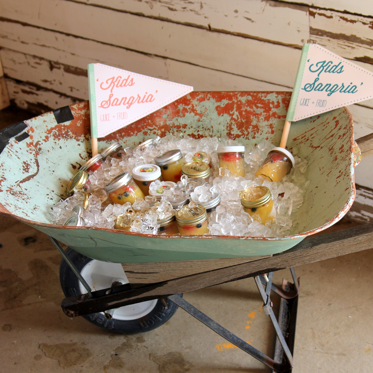 wheel barrel full of 'kid's sangria'
