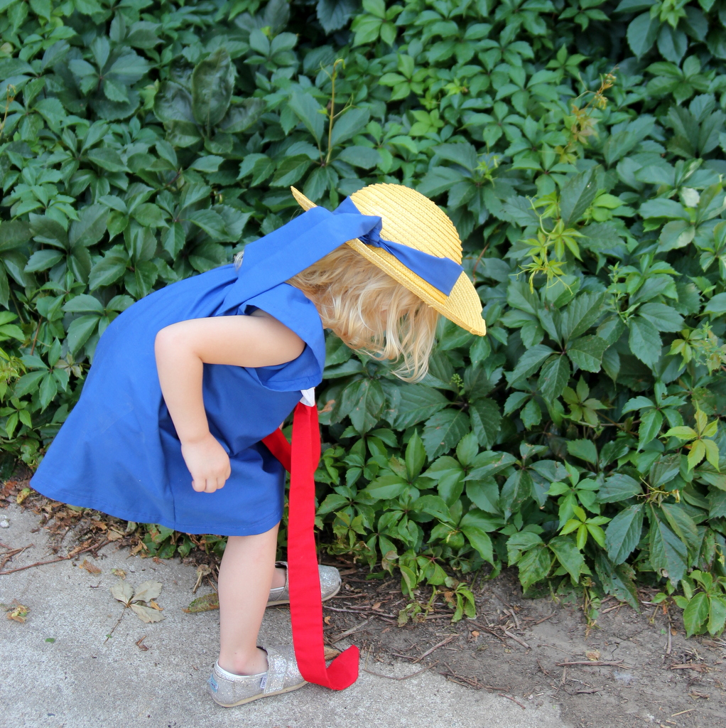 Blue Madeline dress with a white peter pan collar and a red bow