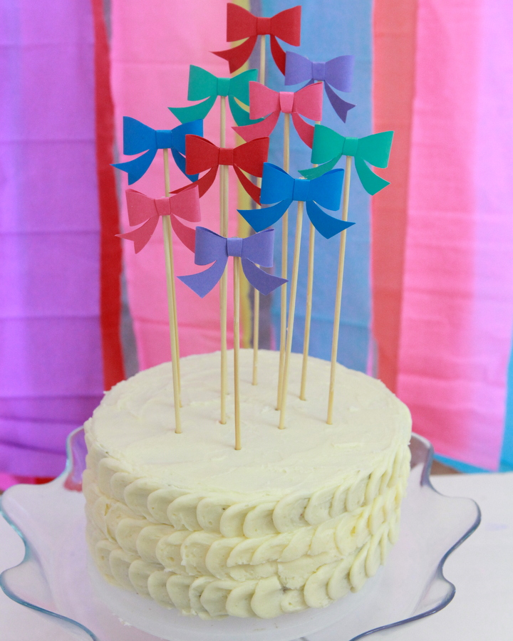 bow party cake topper