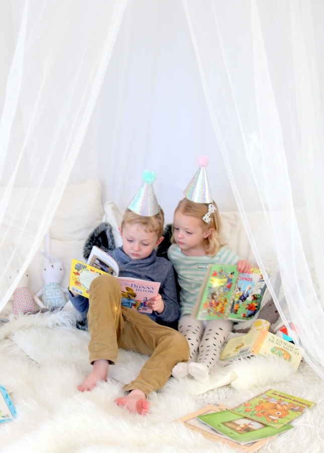 snow bunny party activities- bunny books in a coat tent