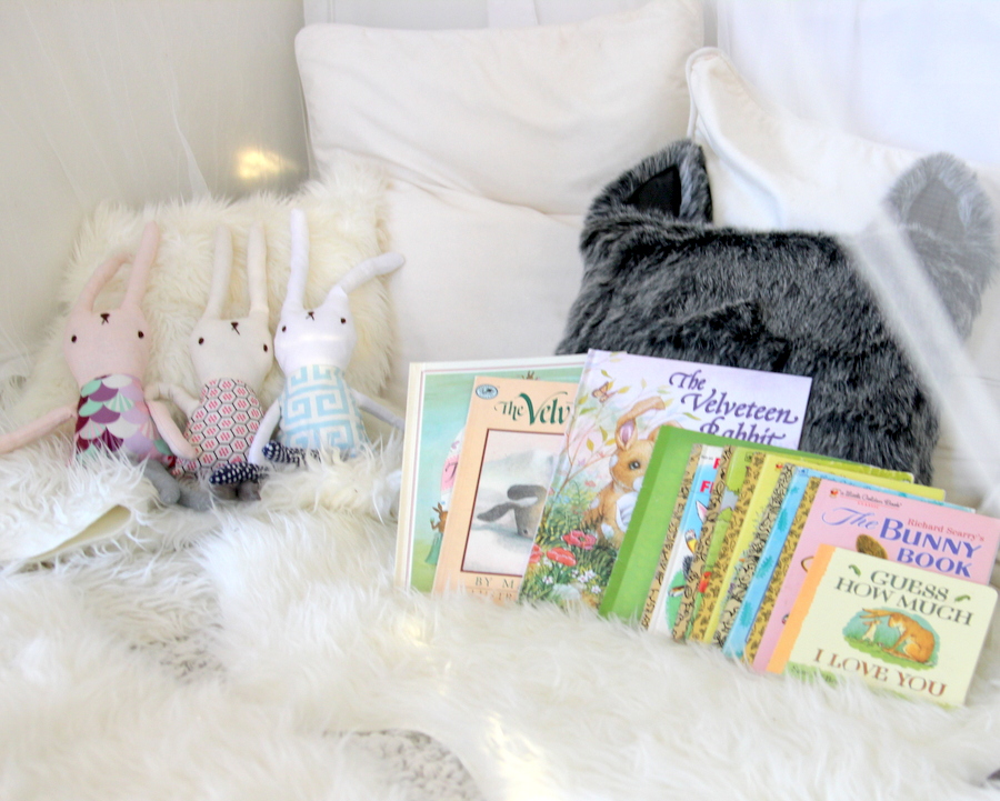 snow bunny first birthday party activities- bunny books in a cozy tent