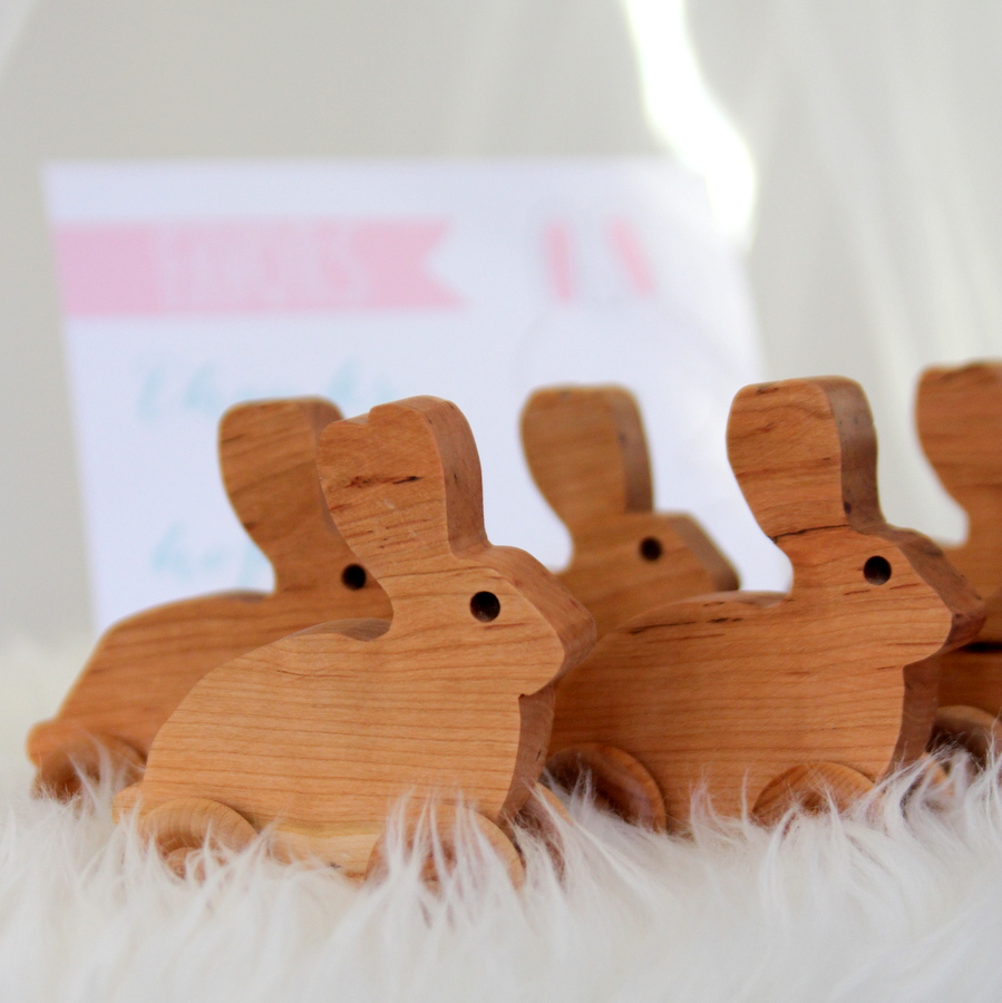 snow bunny first birthday party favors- rolling wooden rabbits by simple.great on etsy