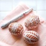 White pen on brown eggs.