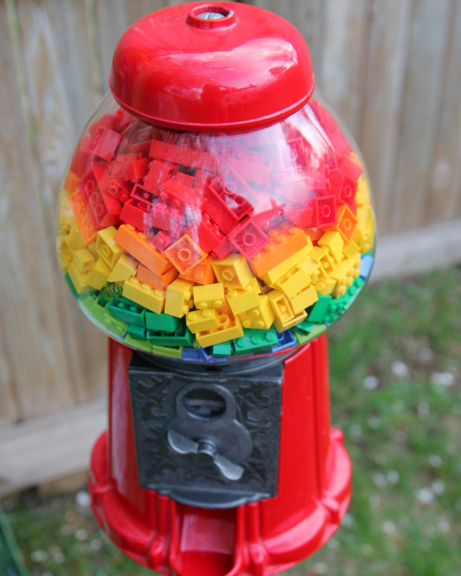 Lego birthday party- layered Legos in a gum ball machine as decor