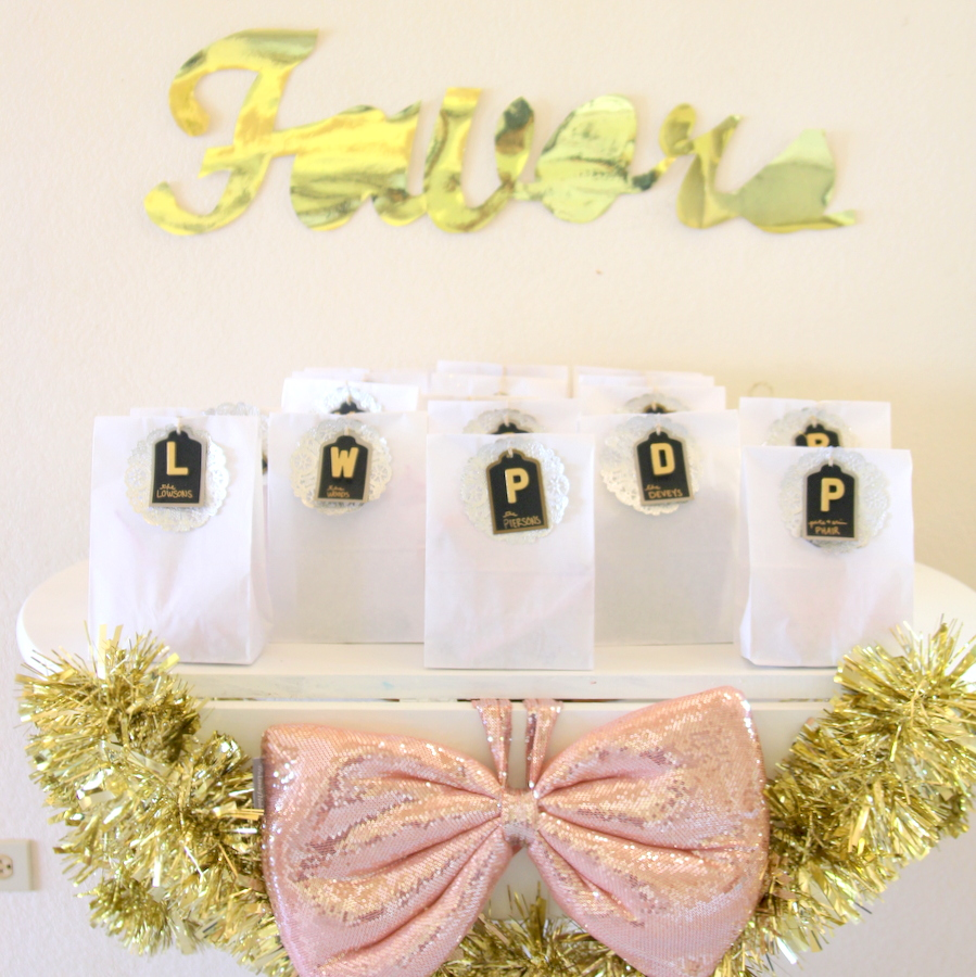 glitter party favor ideas- white paper lunch bags with black lettered tags