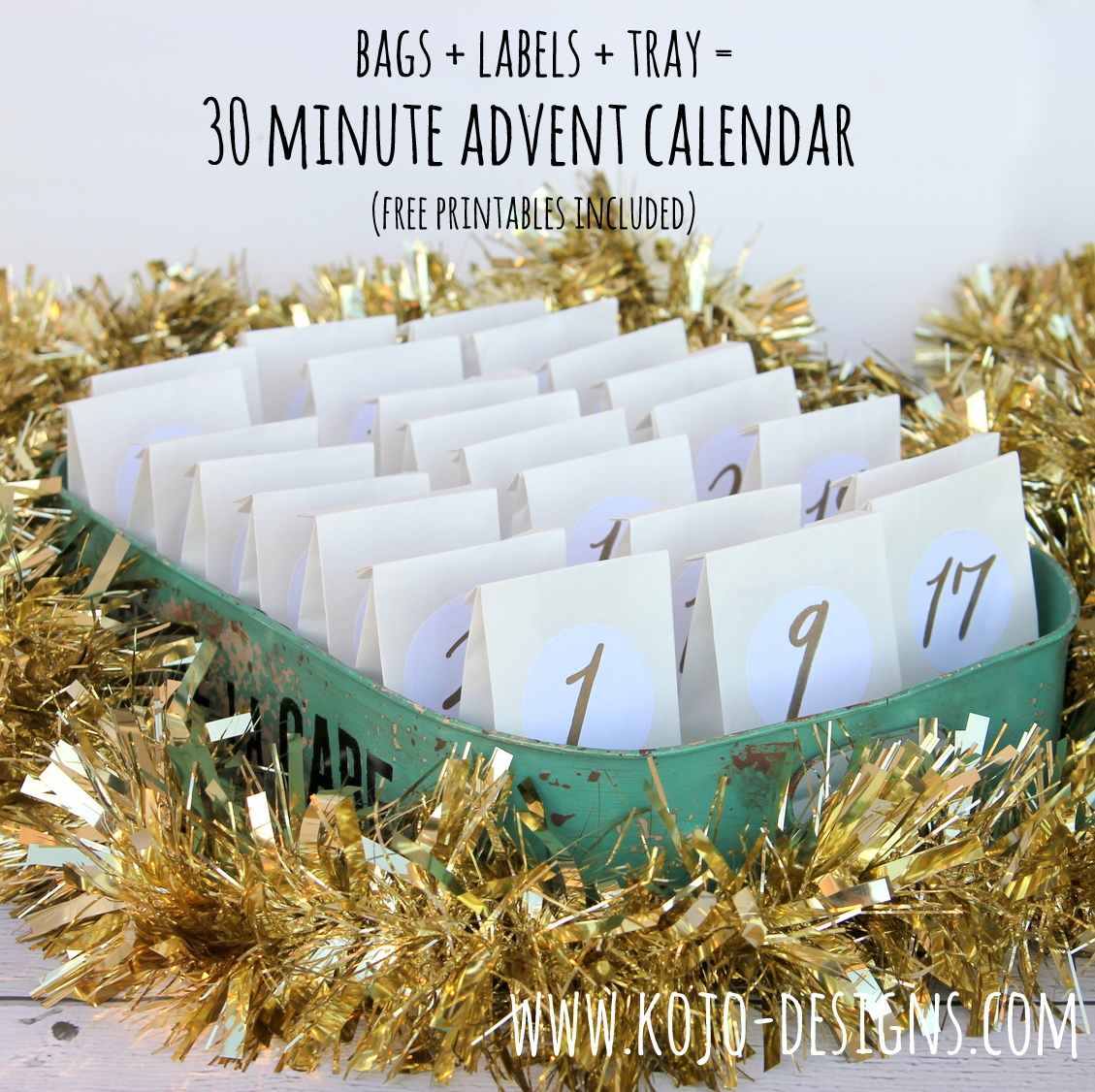 how to put together an advent calendar in 30 minutes (you just need small paper bags, these free printable labels, a tray and treats to fill the bags)