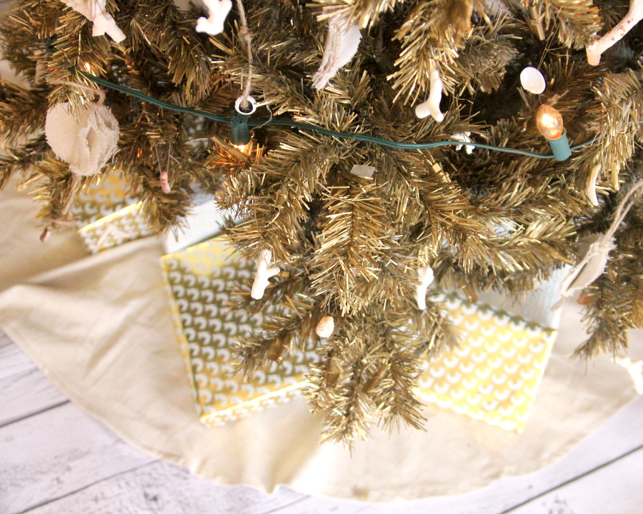 our beach-y gold christmas tree (spray painted gold and decorated with shells and coral)