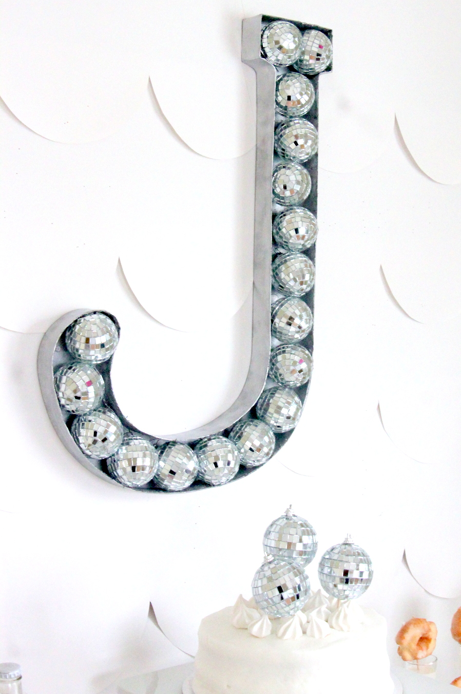 Need to add a bit of rock star to a room (or a party)??? This disco ball filled monogram is the answer!