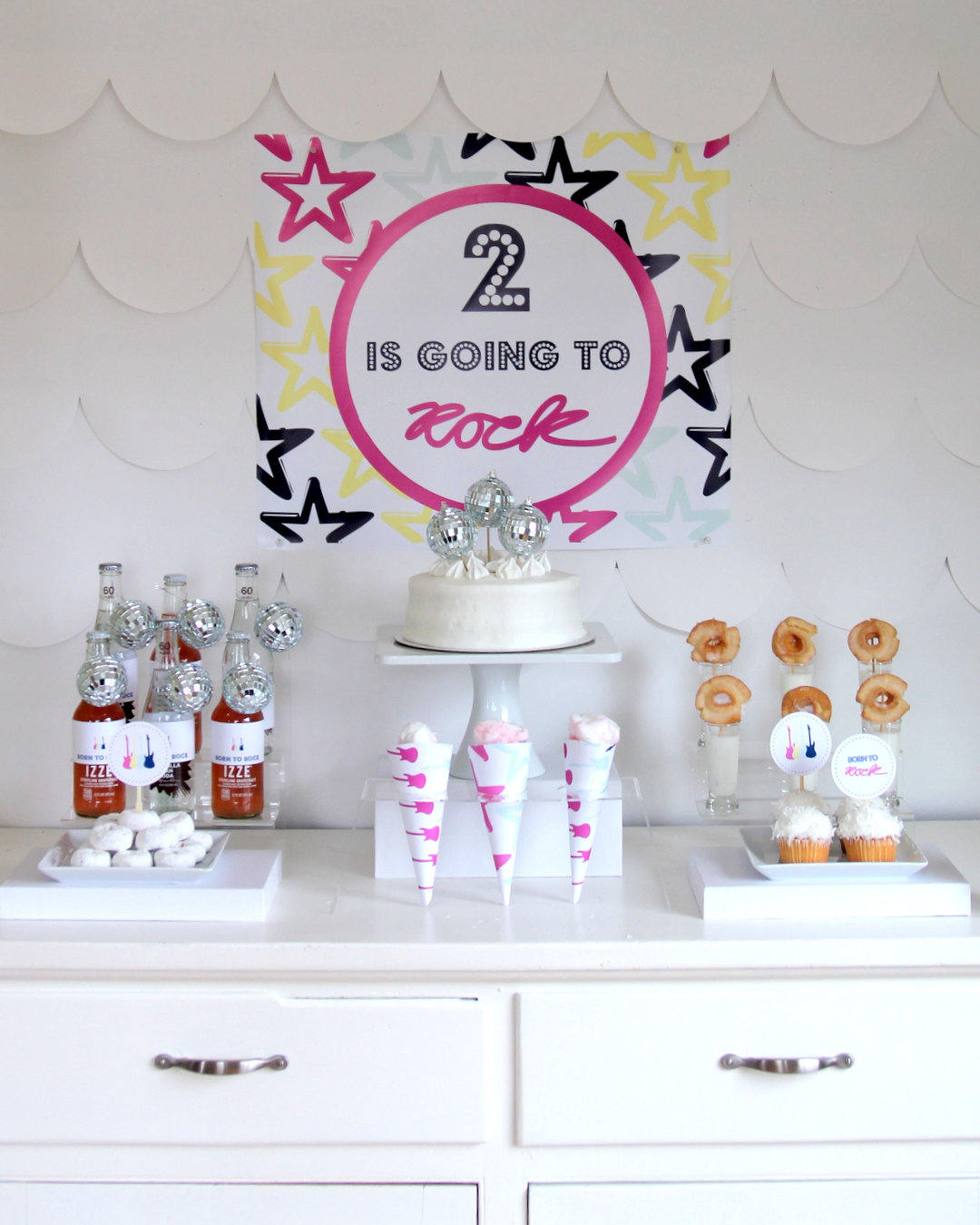 Time to party like a rock star! This sweet rock star birthday party includes all sorts of party ideas- like this super simple treat table!