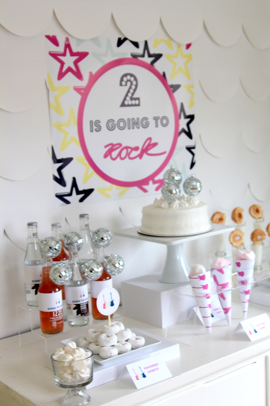 Time to party like a rock star! This sweet rock star birthday party includes all sorts of party ideas- like this sweet treat table set up!