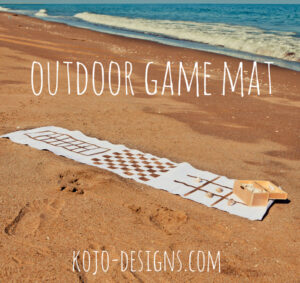 use a table runner to make a game board to take with you on your nest outdoor outing!