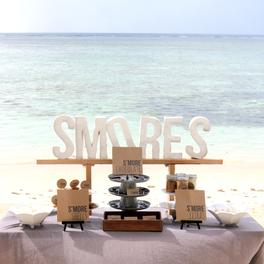 This S'mores Bar is the perfect dessert table- it'd word as a treat table at a party, a wedding dessert table, even a food station at a baby shower!