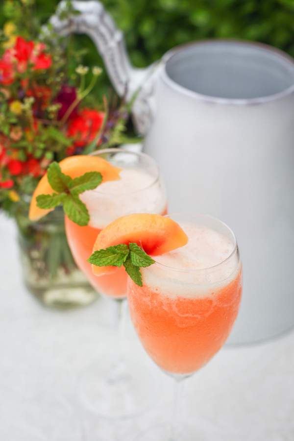 make a pitcher of peach bellinis.