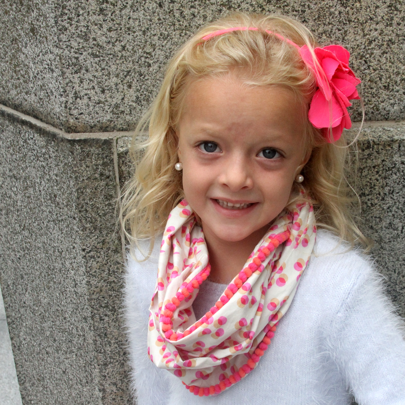 DIY kids' infinity scarf with pom pom trim