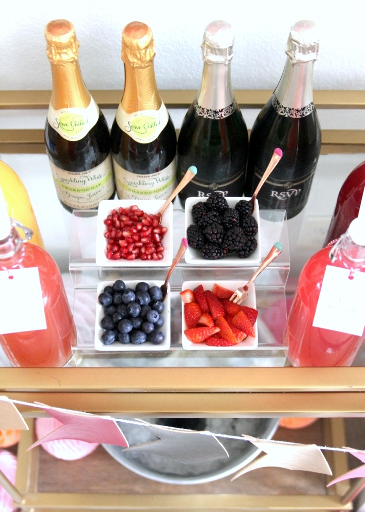 Perfect for baby showers, bridal showers (or even a Valentine's Day bash!)- this pink Mimosa Bar is so fun and SO easy to put together!