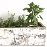 Help your garden transition from summer to fall with this DIY herb planter box