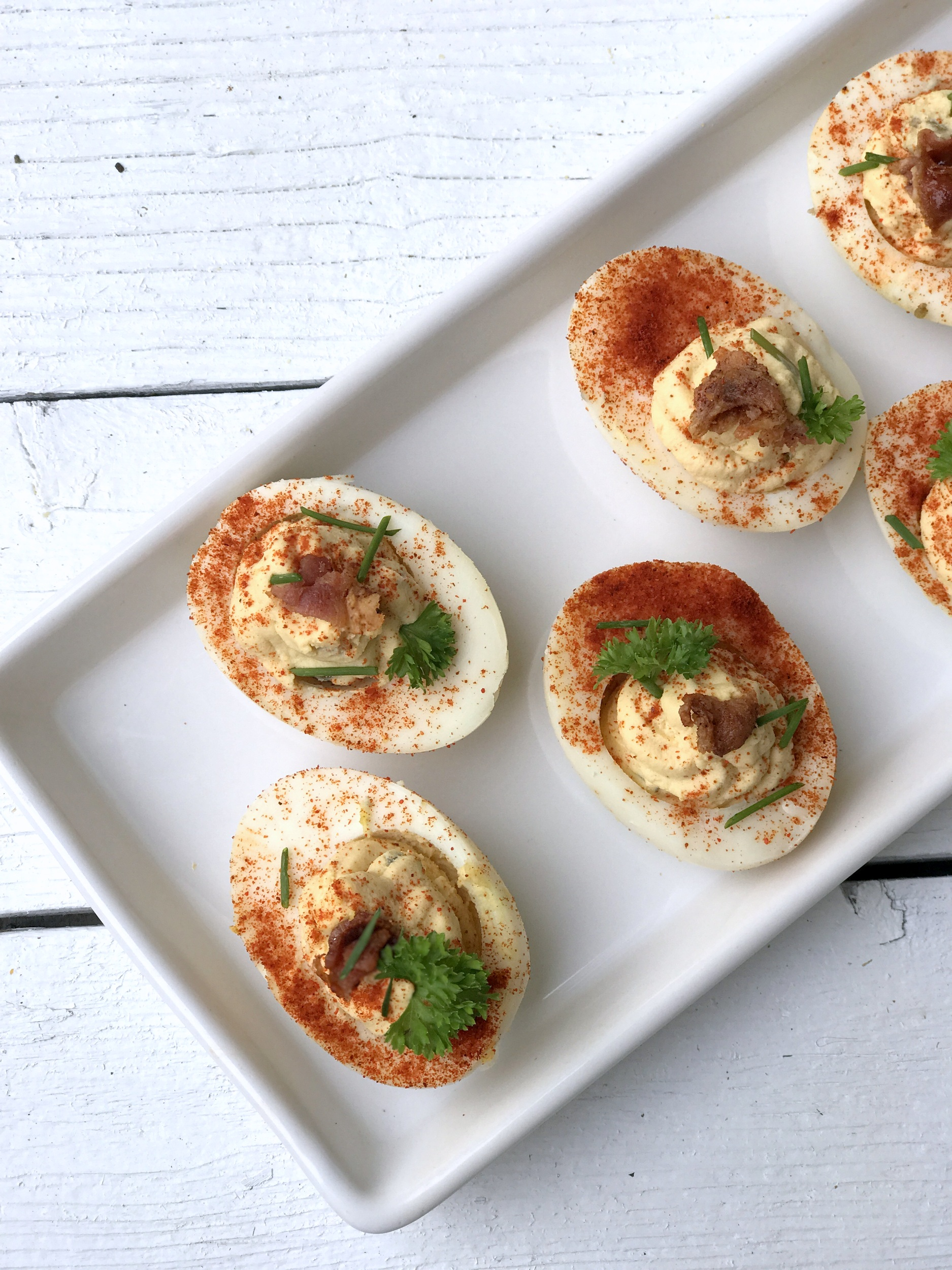 The BEST way to use up leftover hardboiled eggs- Chipotle Deviled Eggs!