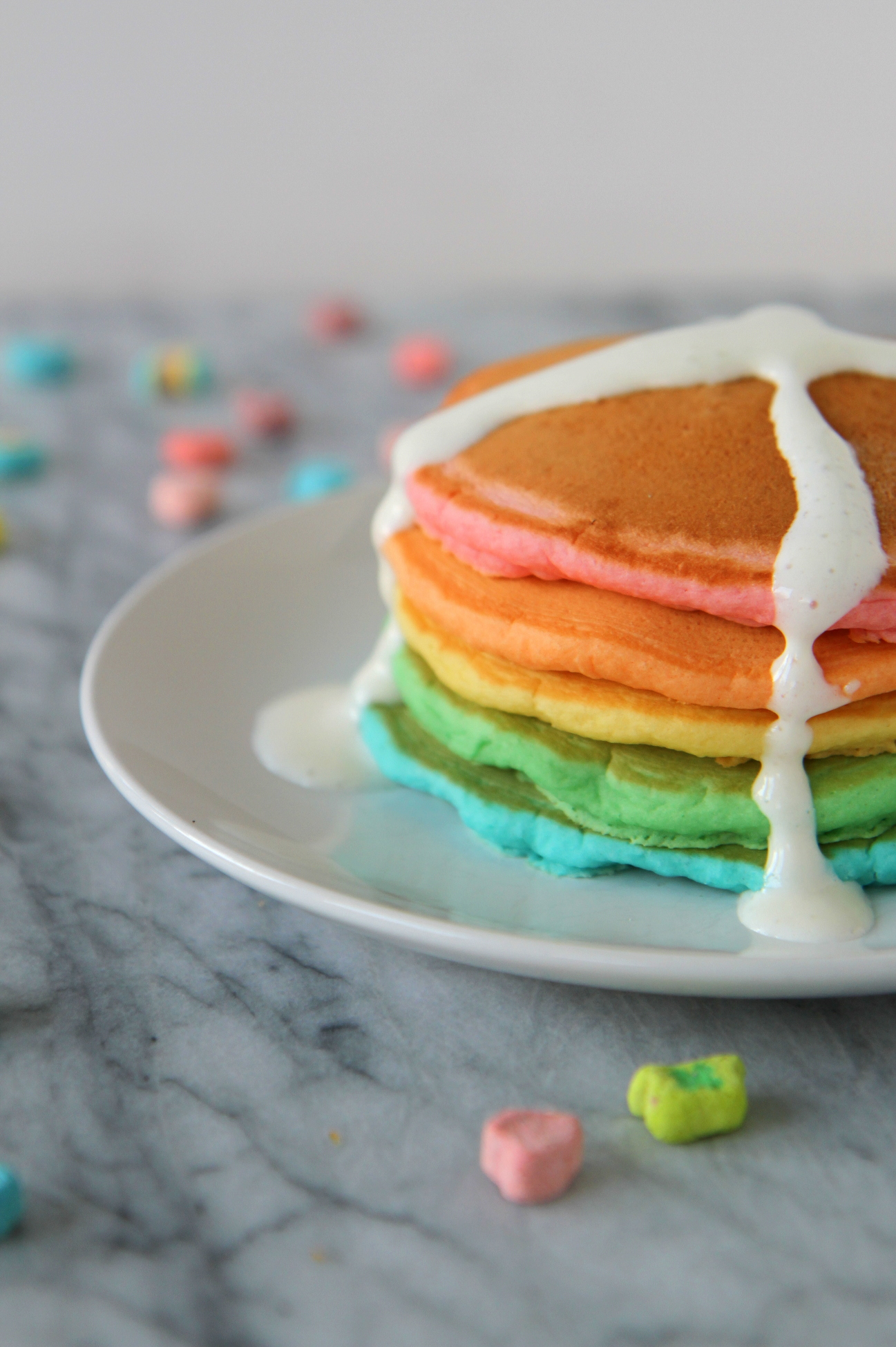 "The perfect pancakes for a big (dessert) celebration (aka ""crazy cakes"")... a stack of rainbow pancakes with a pile of wild toppings!"