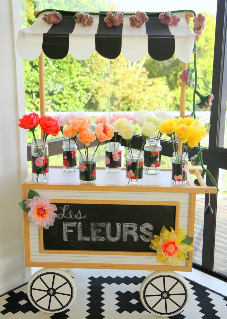 kid's birthday party paper flower bar