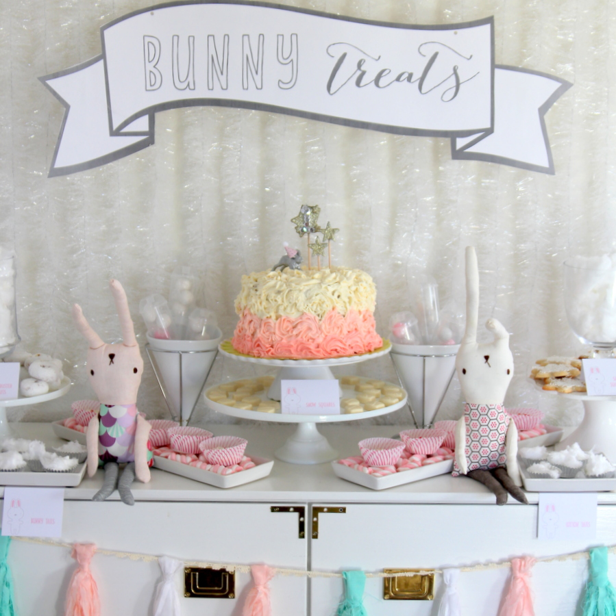 snow bunny themed first birthday party decor