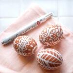 White pen on brown eggs.