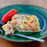 stacked green chile chicken enchiladas