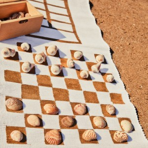 Use a table runner to make an outdoor game mat