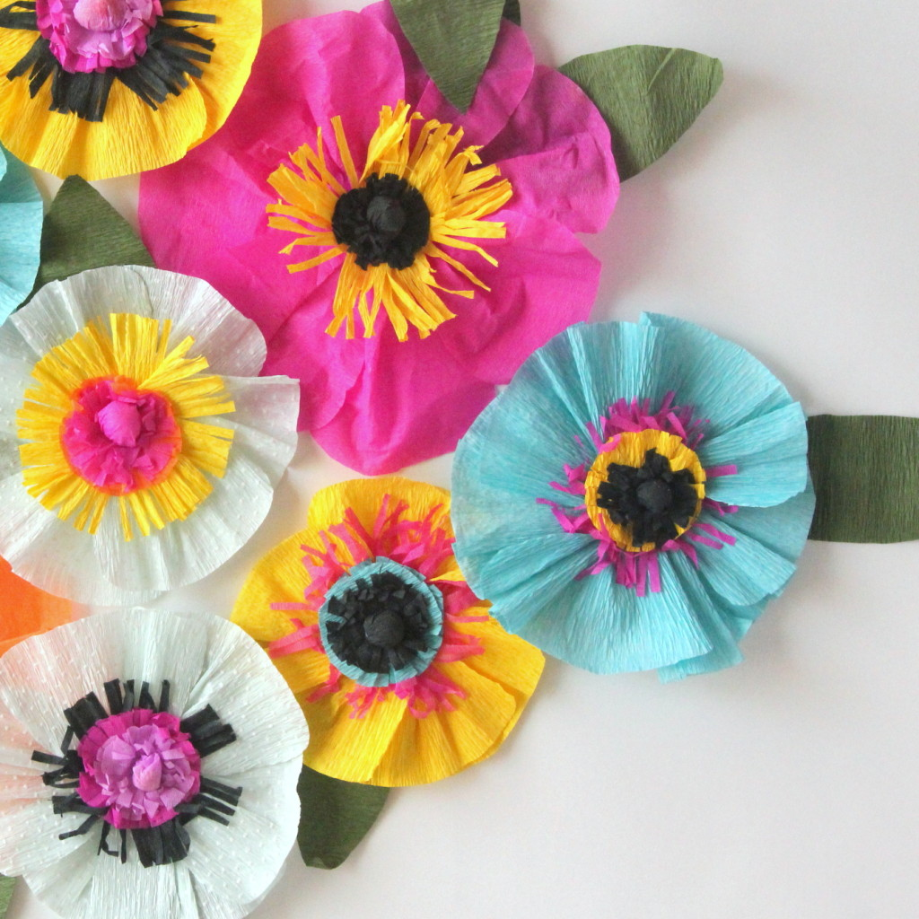 Easiest ever crepe paper flowers - each one takes about ten minutes (or, if you make an assembly line, you can make whole pile in an hour!). Party decor (or even room decor!) perfection.