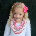DIY kids' infinity scarf with pom pom trim
